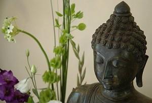 Buddha head and flowers